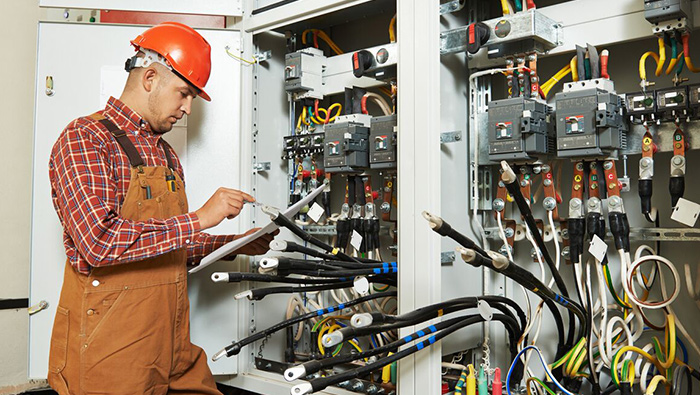 Electrician working on an electrical system