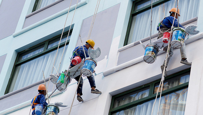 Team painting the exterior of a building.